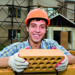 The young builder on construction of a house.